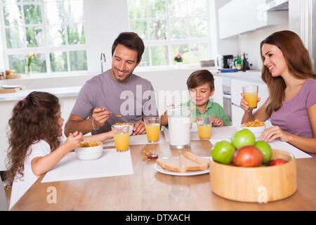 Family eating healthy breakfast - Stock Photo