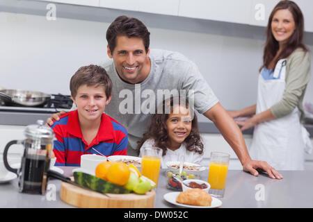 Happy family having breakfast - Stock Photo