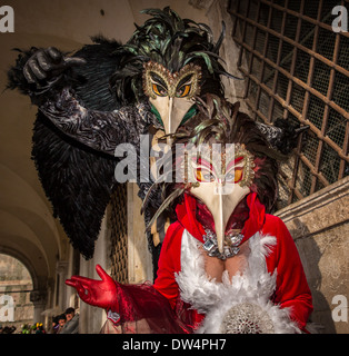 Two persons dressed up as birds for the Carnival in Venice, Italy, Europe - Stock Photo