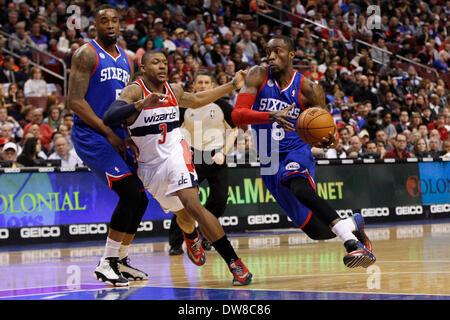 March 1, 2014: Philadelphia 76ers shooting guard Tony Wroten (8) drives to the basket as power forward Arnett Moultrie - Stock Photo