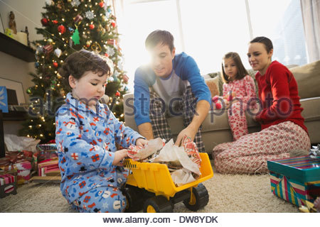 Father and son playing with truck at Christmas - Stock Photo