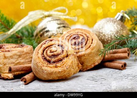 Cinnamon rolls in christmas settingCinnamon rolls in christmas setting - Stock Photo