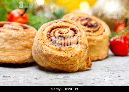 Delicious cinnamon rolls on christmas table. Selective focusDelicious cinnamon rolls on christmas table. Selective - Stock Photo