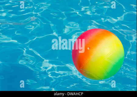 Beachball in a swimming pool - Stock Photo