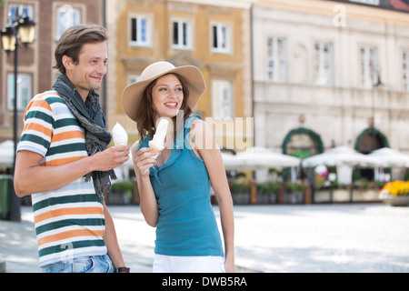 Tourist couple enjoying ice cream cones during vacation - Stock Photo