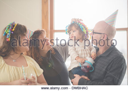 Mature man with daughters and granddaughter - Stock Photo