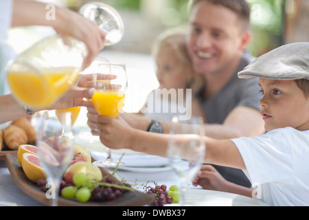 Family dining outdoors - Stock Photo