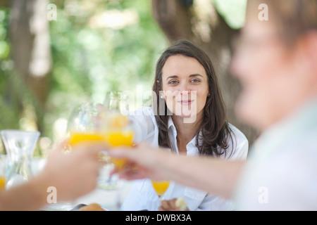 Family toasting outdoors - Stock Photo
