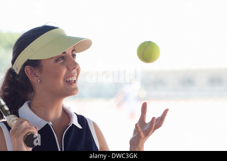 Tennis player tossing ball - Stock Photo