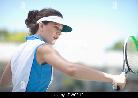 Tennis player slicing - Stock Photo