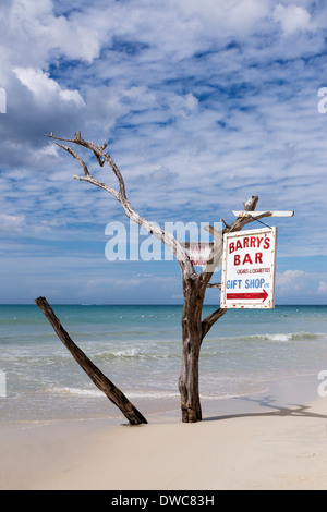 Driftwood sign for beach bar, Negril, Jamaica - Stock Photo