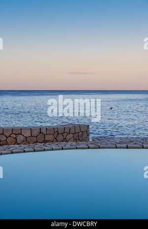 Spa pool overlooking the ocean, Negril, Jamaica - Stock Photo