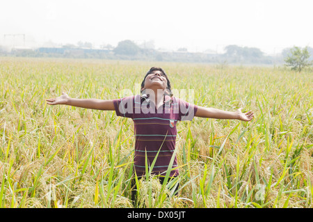 1 Indian kid Standing in Farm - Stock Photo