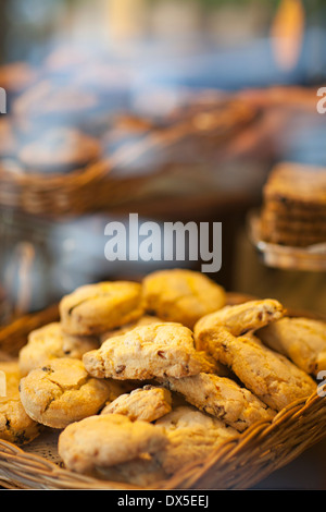 Cookies in basket in bakery window display, close up - Stock Photo