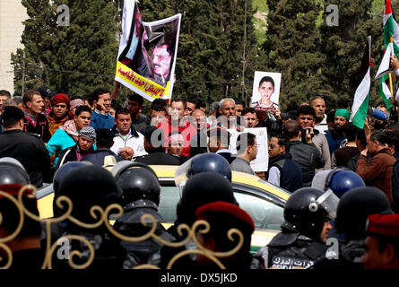 Amman, Amman. 18th Mar, 2014. Relatives of Ahmed Daqamseh, a Jordanian soldier who was sentenced to life imprisonment - Stock Photo