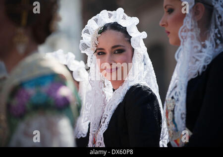Valencia, Spain. 18th Mar, 2014. A woman in traditional costume is seen during the Fallas Festival Parade to offer - Stock Photo