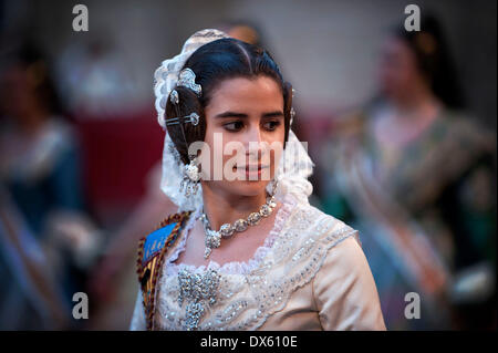 Valencia, Spain. 18th Mar, 2014. A girl in traditional costume is seen during the Fallas Festival Parade to offer - Stock Photo