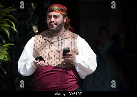 Valencia, Spain. 18th Mar, 2014. A man in traditional costume is seen during the Fallas Festival Parade to offer - Stock Photo