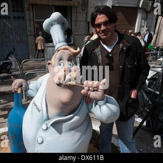 Valencia, Spain. 18th Mar, 2014. Designer Pedro pose with his gigantic doll during the Fallas Festival in Valencia, - Stock Photo