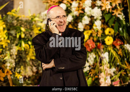 Valencia, Spain. March 18th, 2014: The archbishop of Valencia, Carlos Osoro, talks with someone by mobile phone - Stock Photo
