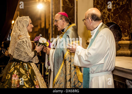Valencia, Spain. March 18th, 2014:   The 'Fallera Mayor' 2014, Carmen Sancho de Rosa, offers flowers to the Lady - Stock Photo