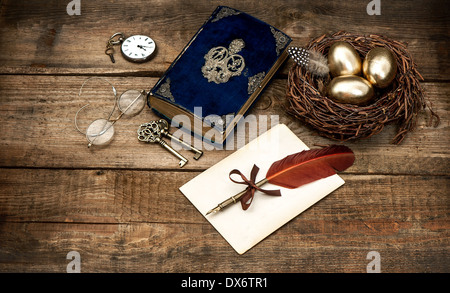 vintage easter still life composition. decoration with eggs and antique bible book - Stockfoto