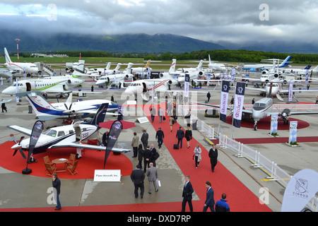 Aircraft at the 2013 Ebace exhibition at Geneva International Airport, Switzerland. - Stock Photo