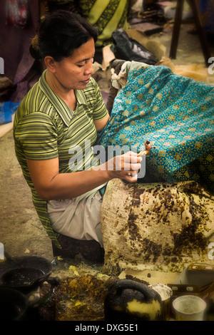 ... Surakarta crafts Batik Keris Factory batik workers hand waxing batik