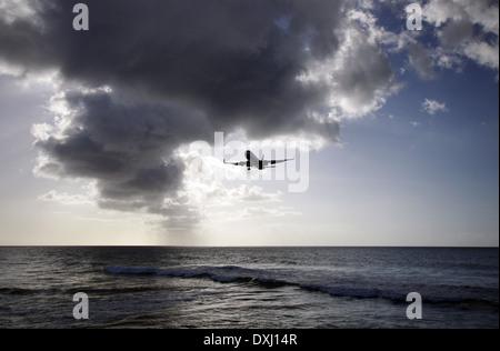 British Airways Boeing 777 landing in Tobago - Stock Photo