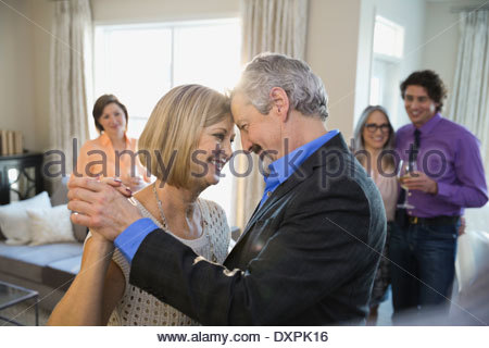 Romantic couple dancing at party - Stock Photo