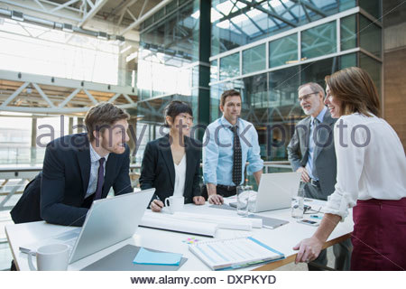 Business people meeting around conference room table - Stock Photo