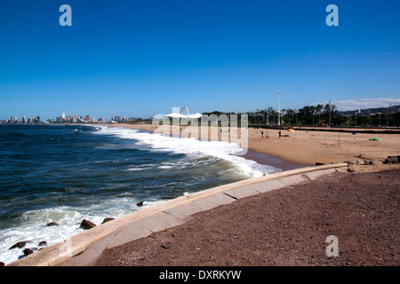 View of Fishermen On Blue Lagoon Beach Against City Skyline in Durban South Africa - Stock Photo