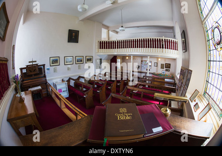 Interior of a church with a Bible on display viewed through a fisheye lens; Lake District, Cumbria, England - Stock Photo