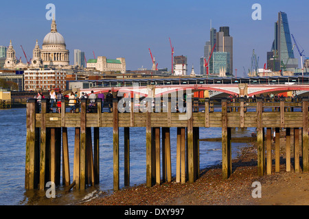 Wooden pier at Oxo Tower Wharf on the River Thames with Blackfriars Bridge and the City of London skyline in London, - Stock Photo