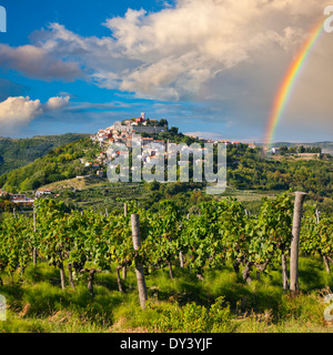 Motovun on the hill after rain with rainbow on the sky, Croatia - Stock Photo