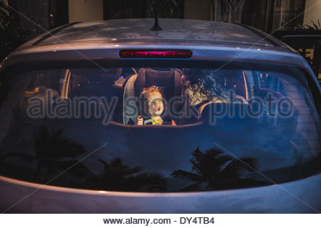 Mother and daughter sitting in car - Stock Photo