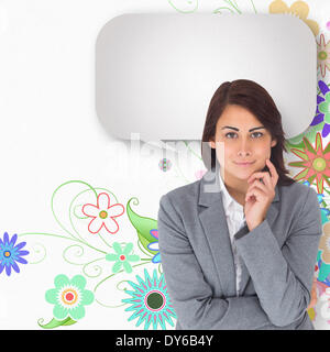 Composite image of smiling thoughtful businesswoman with speech bubble - Stock Photo