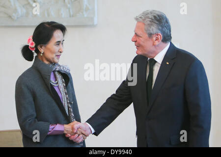 Berlin, Germany. 10th Apr, 2014. Myanmar opposition leader Aung San Suu Kyi (L), shakes hands with German President - Stock Photo