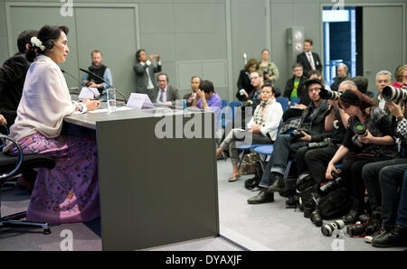 Berlin, Germany. 12th Apr, 2014. The Burmese Nobel Peace Prize Laureate Aung San Suu Kyi (2ND-L) is pictured during - Stock Photo