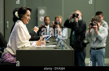 Berlin, Germany. 12th Apr, 2014. The Burmese Nobel Peace Prize Laureate Aung San Suu Kyi (L) is pictured during - Stock Photo