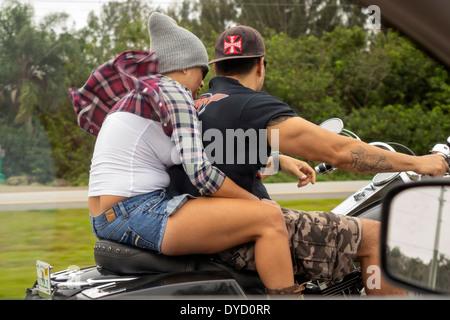 Miami Florida Tamiami Trail Route 41 Hispanic man woman couple riding motorcycle rushing air wind view through car - Stock Photo