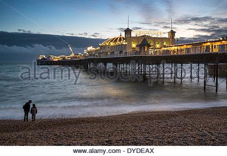 Winter sunset over Brighton Pier on the south coast. - Stock Photo