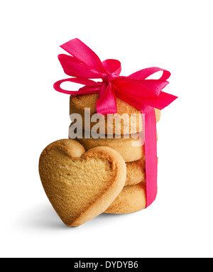 shortbread biscuits in the shape of a heart with a red bow isolated on a white background - Stock Photo