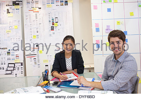 smiling Businessman and businesswoman in office - Stock Photo