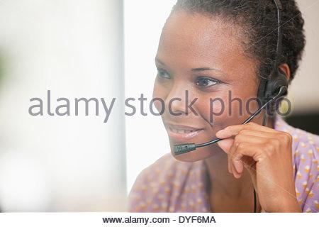 Close up of happy businesswoman using headset - Stockfoto