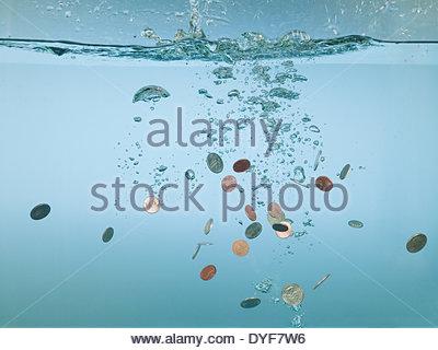 Euro coins splashing in water - Stock Photo