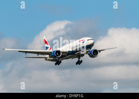 British Airways 777 aircraft with landing gear down on approach to land - Stock Photo