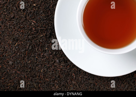 Black Tea in a teacup with plenty of copy space - Stock Photo