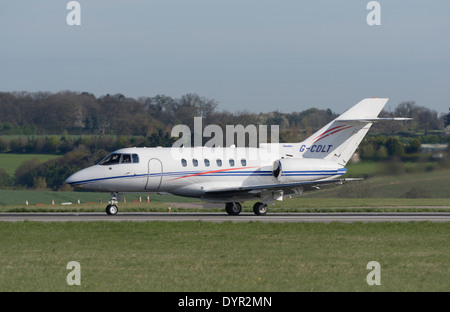 Hawker 800XP business jet taking off - Stock Photo
