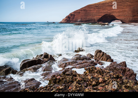 Red arches on atlantic ocean coast, Legzira beach, Sidi Ifni, Morocco, North Africa - Stock Photo